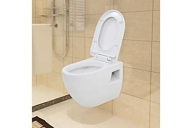Toalett i hvit keramikk veggmontert