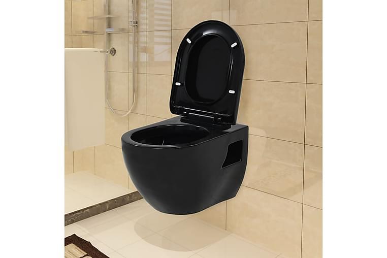 Vegghengt toalett i svart keramikk