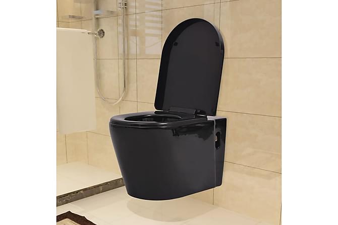Vegghengt toalett med skjult sisterne svart keramikk - Baderom - Toaletter - Bideter