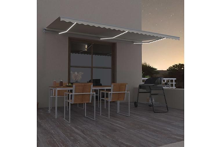 Manuell uttrekkbar markise med LED 600x350 cm kremhvit - Krem - Hagemøbler - Solbeskyttelse - Markiser