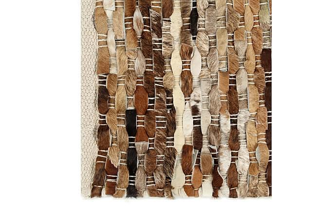 Teppe ekte kuskinn med hår 80x150 cm brun/hvit - Innredning - Tepper & Matter - Skinn & pelstepper
