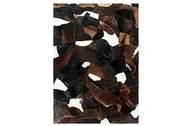 Lappeteppe ekte kuskinn med hår 80x150 cm svart/hvit/brun